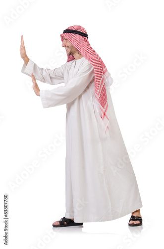 Arab man pushing away  virtual obstacle  isolated on white