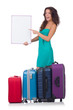 Woman preparing for vacation with suitcases and blank board isol