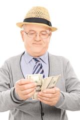 Senior gentleman counting money