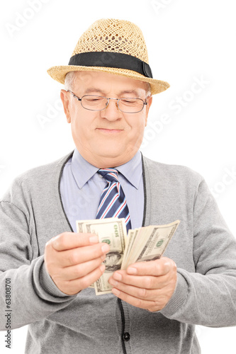 Senior gentleman counting money