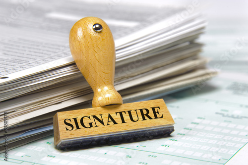 signature marked on rubber stamp with documents