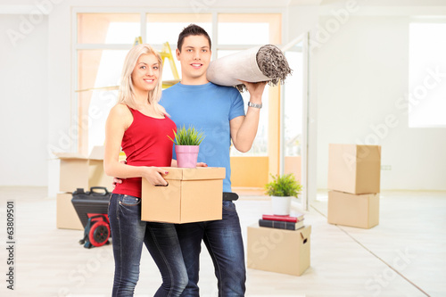 Young couple moving into a new apartment
