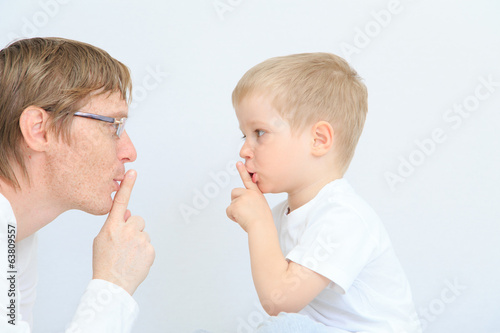 father and son sharing secret