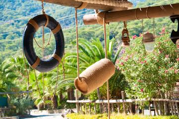 Lifebuoy, marine decor, wooden canopy for recreation