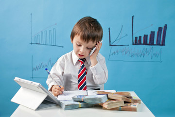 Young boy, talking on the phone, writing notes, money and tablet