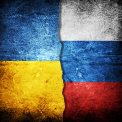 Ukraine and Russia Flag on grunge wall