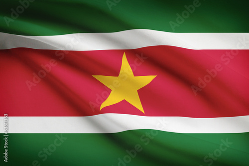 Series of ruffled flags. Republic of Suriname.