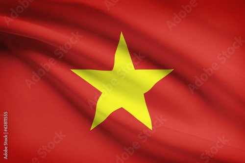 Series of ruffled flags. Socialist Republic of Vietnam.