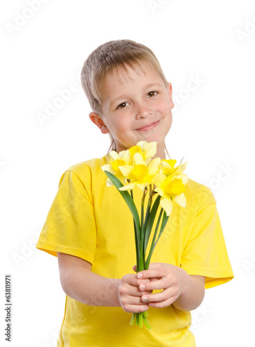 Portrait of happy joyful beautiful little boy with flowers