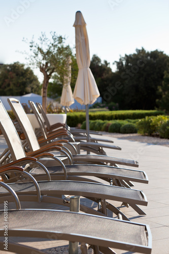 Hotel Poolside Chairs Row