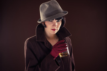 beautiful fashionable woman in the image of the detective
