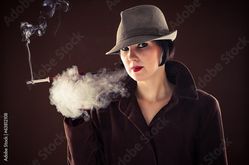 woman in the image of detective smoking a cigarette