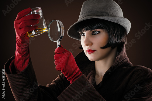 woman detective examines the evidence