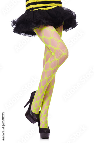 Woman legs in yellow fishnet isolated on white