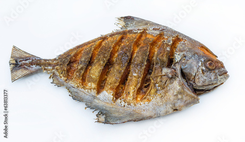 Asian style deep fried pomfret in white isolated background