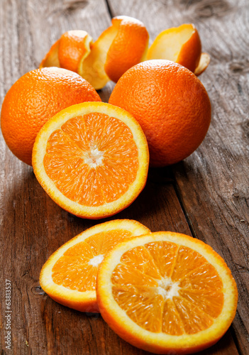 Group of oranges on a wooden table