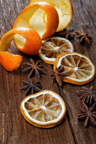 Dried peel of an orange and spice on a table