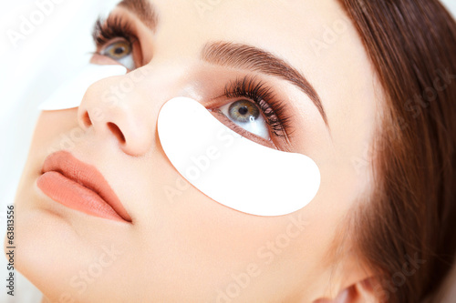 Poster Cosmetic Treatment. Woman Eye with Long Eyelashes. Eyelash Exten