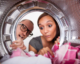 Young couple doing laundry