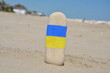 National flag of Ukraine on a vertical stone