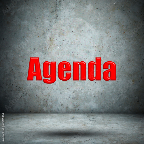 Agenda on concrete wall