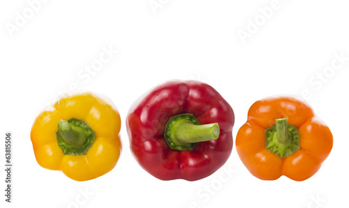 Tricolor paprika peppers , top view, isolated on white