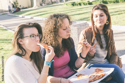 Girls Eating Pizza in the City