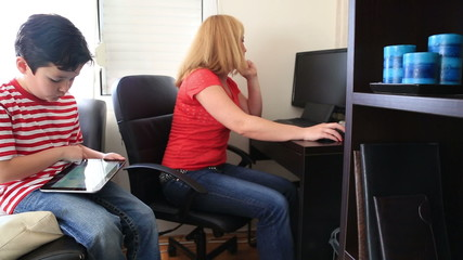 Woman trying to work in home office with computer