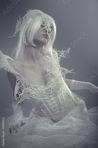 Fantasy concept, sensual young woman with beautiful corset