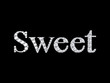 word sweet diamond sign on black background
