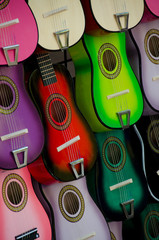 Stand with colorful little wooden guitars at Market Square, San