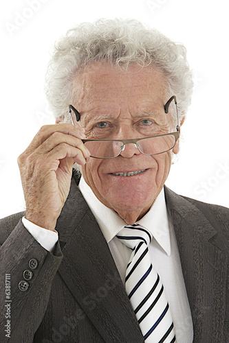 Senior Executive portrait holding eyes glasses in his hand