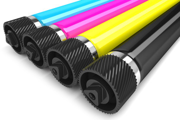 Printer CMYK rollers isolated on white background
