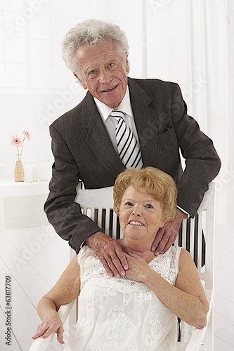 Senior couple looking to camera