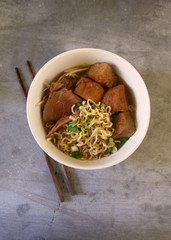 Chinese style noodle served with duck and tofu