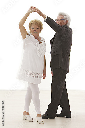 Senior couple dancing rock & roll
