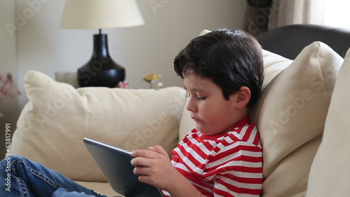 Child Using a Touch Screen Tablet PC
