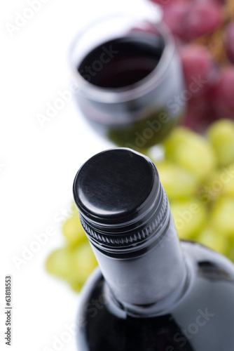 bottle of wine and grapes, isolated