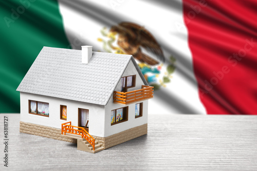 classic house against Mexican flag background