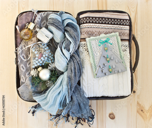 Small road suitcase with warm clothes, women's jewelry and handm