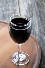 glass of red wine on a wooden board
