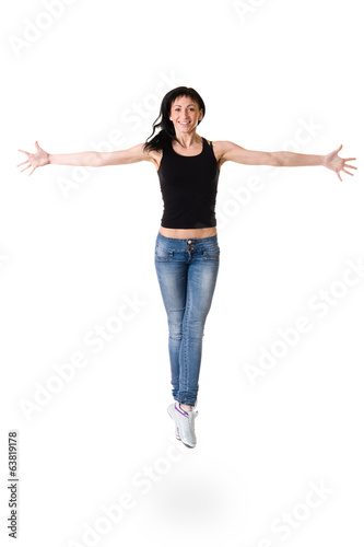 young dancer woman jumping against white background