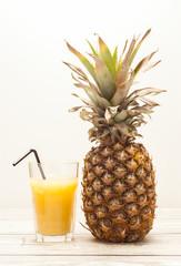 Pineapple on wooden board
