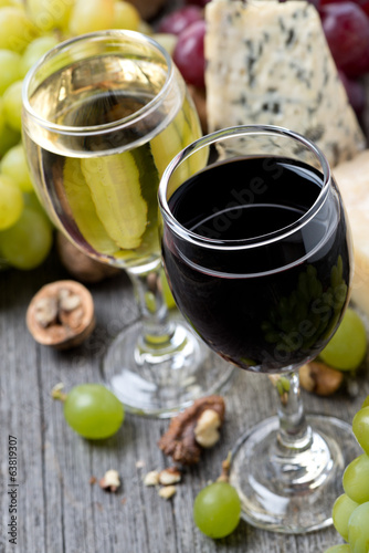 red and white wine, grapes, walnuts and cheeses