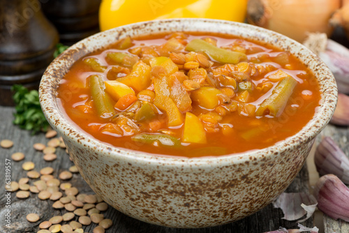 Spicy tomato soup with lentils and vegetables in a bowl