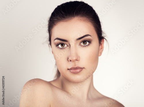 Skin facial care. Young attractive woman  posing in studio