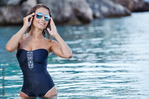 beautiful woman posing on the beach in Croatia