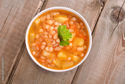 Bean soup on wooden table