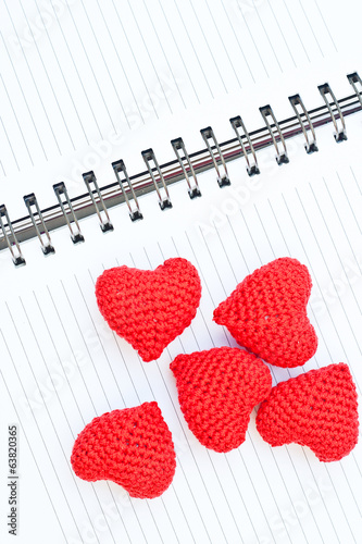 five red knit hearts