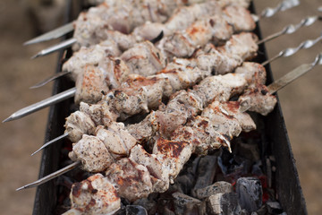 Marinated shashlik, lamb meat grilling on metal skewer